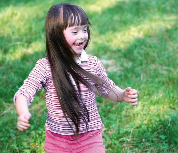 Image of smiling female child running.